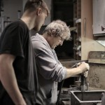foreman-teaching-apprentice-working-with-tools-3846258